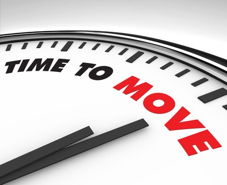 White clock with words Time to Move on its face Stock Photo - 7516369