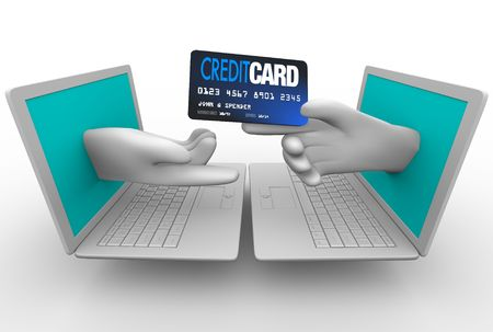 A hand extends with a credit card for an online purchase Stock Photo - 7574391