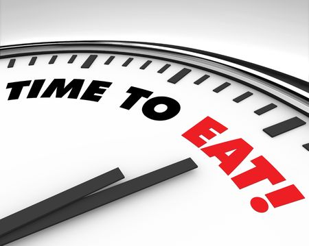 alerts: White clock with words Time to Eat on its face Stock Photo