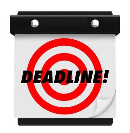 The word Deadline and a red target on a hanging wall calendar photo