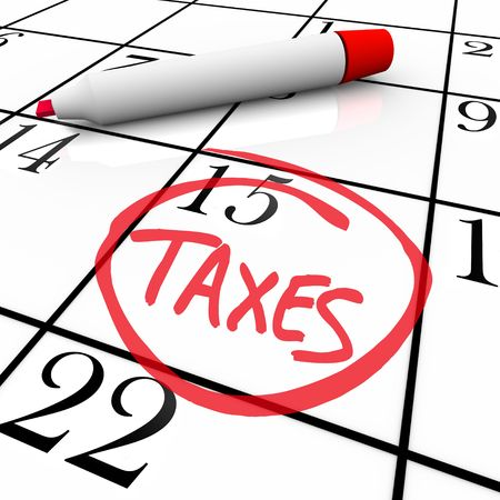 taxes budgeting: The big Tax Day, the 15th, is circled on a white calendar with a red marker Stock Photo