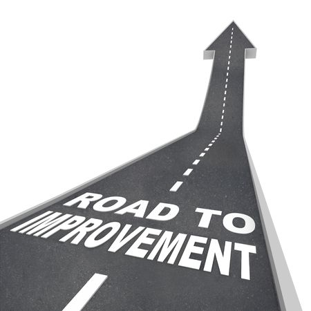 The words Road to Improvement in white letters on a street leading to an arrow symbolizing growth Stock Photo - 8183907