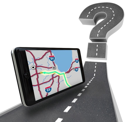 gps: A GPS navigation unit on a road leading to a question mark symbolizing finding a route Stock Photo