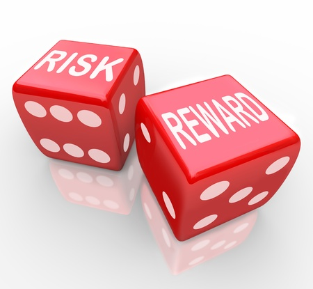 reward: Two red dice with the words Risk and Reward symbolizing taking a chance on a new opportunity