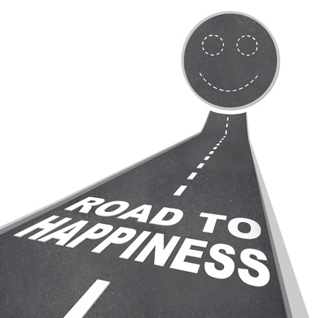 The words Road to Happiness in white letters on a street leading to a smiley face Stock Photo - 8370904