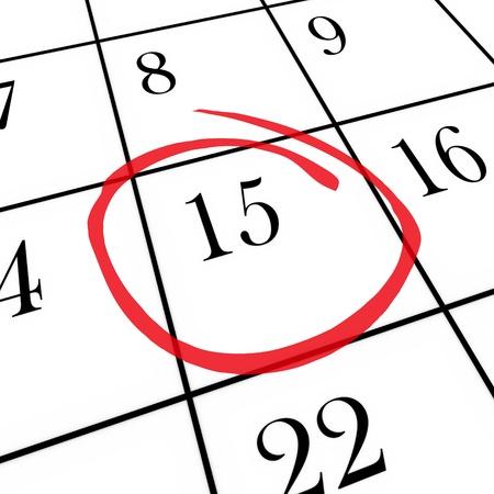 circled: Un calendario mensual en un tablero blanco con el d�a 15 en un c�rculo con marcador rojo