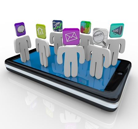 Several people with apps for heads stand on a smart phone representing applications or software installed on the device photo