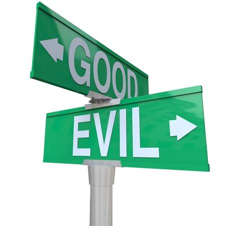 Een groene twee richtings straat teken naar goed of kwaad, symboliseert de innerlijke conflict van het geweten Stockfoto