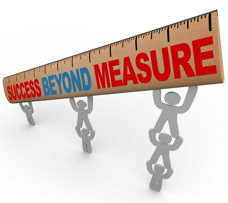 A team lifts a ruler with the words Success Beyond Measure, symbolizing the result of teamwork and synergy photo