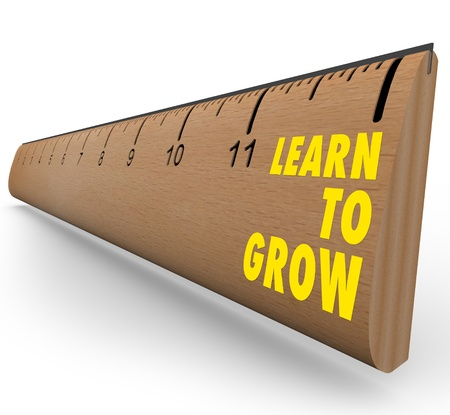 A wooden ruler with the words Learn to Grow, symbolizing the benefits of lifelong learning photo