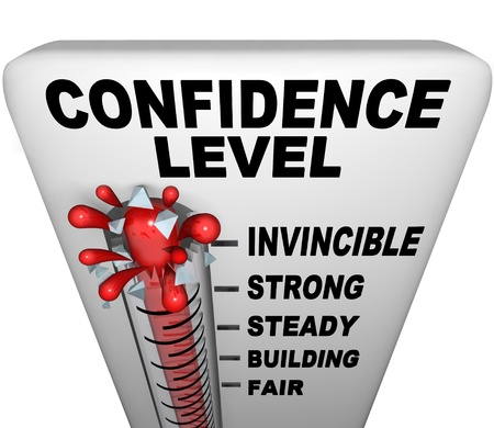 A thermometer with mercury bursting through the glass, and the words Confidence Level, symbolizing a positive attitude Stock Photo