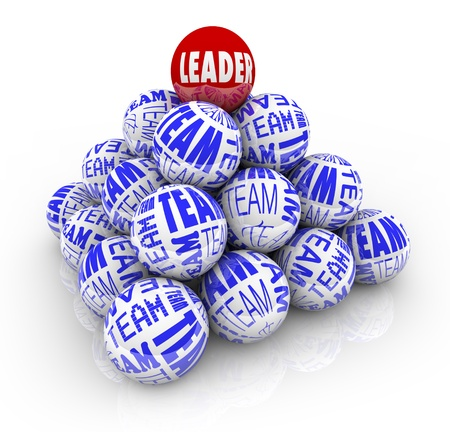 Many balls with the words Team and one reading Leader forming a pyramid symbolizing the cooperation within an organization needed to achieve goals Stock Photo - 8610746