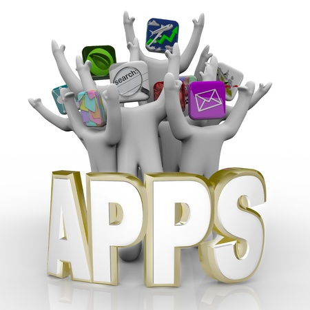 mobile app: Several people with application icons as heads stand cheering behind the word Apps Stock Photo