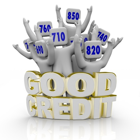 financial report: Several people with great credit scores on their heads cheer behind the word Good Credit Stock Photo