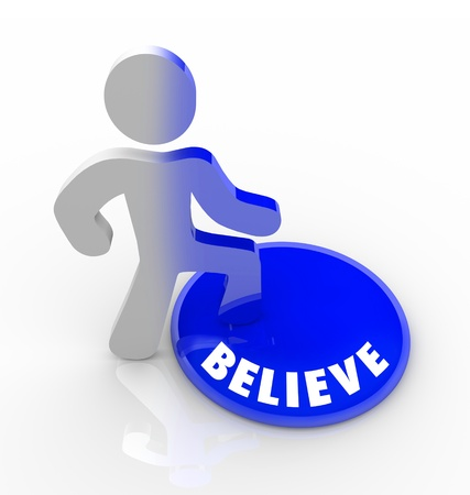 believe: A person stands onto a button marked Believe and his color transforms to symbolize his self confidence and belief Stock Photo