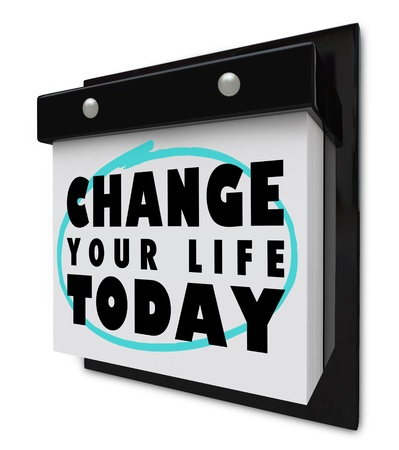 A wall calendar with tear-away pages, and words that read Change Your Life Today