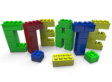 The word Create constructed with small plastic toy blocks of several colors, symbolizing creativity and imagination 免版税图像