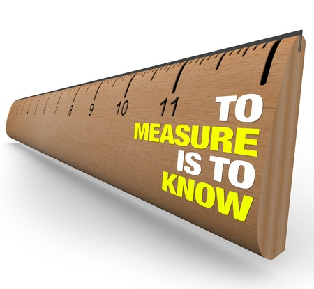 measured: A wooden ruler with the words To Measure is to Know, symbolizing the importance of gathering information when attempting to learn the nature of an object or issue Stock Photo