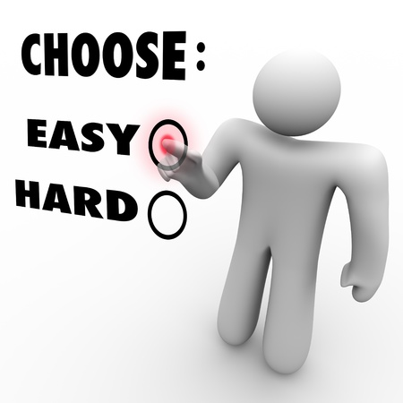 easy: A man presses a button beside the word Easy when asked to choose a difficulty level Stock Photo