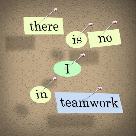 Pieces of paper each containing a word pinned to a cork board reading There is No I in Teamwork photo