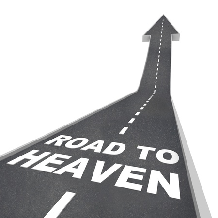 The words Road to Heaven in white letters on a street leading to an arrow symbolizing faith in a religious life
