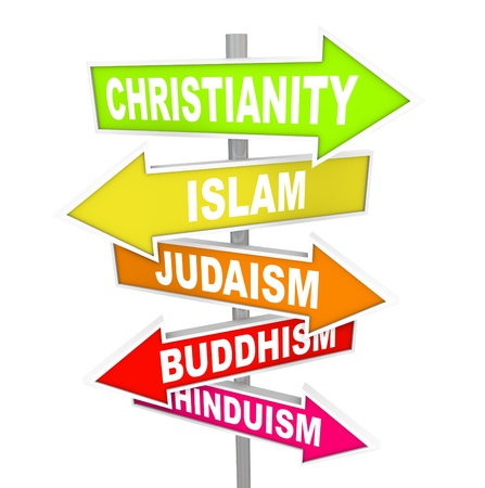 Several colorful arrow street signs with the names of five major world religions - Christianity, Islam, Judaism, Buddhism and Hinduism