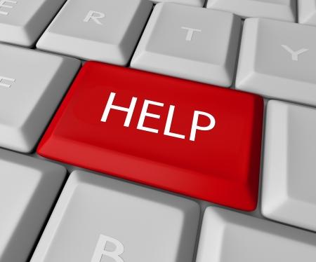 Een toetsenbord met een rode toets Help lezen, symboliseert een dringende behoefte aan bijstand Stockfoto - 9278560