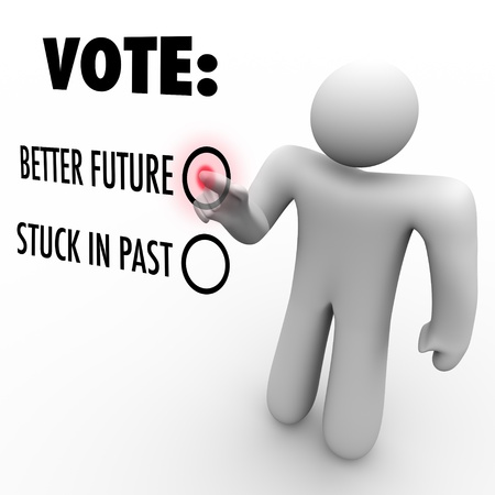 stuck: A man presses a button beside the word Vote and choosing between a better future and being stuck in the past Stock Photo