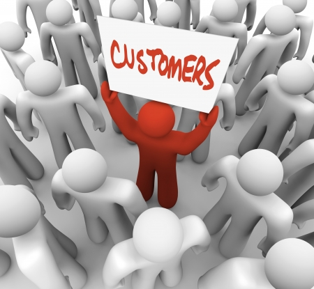 customers: A red person stands out in a crowd holding a sign reading Customers, symbolizing the targeting of consumers in a marketing campaign Stock Photo