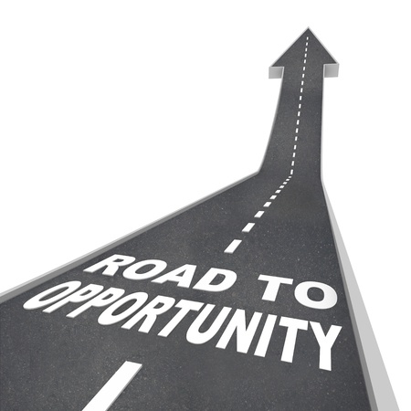 The words Road to Opportunity in white letters on a street leading to an arrow symbolizing change, success and a chance at greatness Stock Photo - 9391676