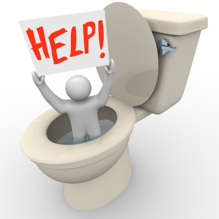 A man holding a sign reading Help is being flushed down the toilet and needs assistance to get him out of his emergency situation Archivio Fotografico
