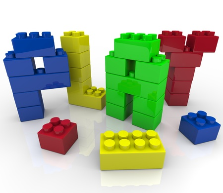 imaginative: The word play created in toy building blocks, symbolizing the creativity and imagination involved in constructing a creation with educational toys Stock Photo