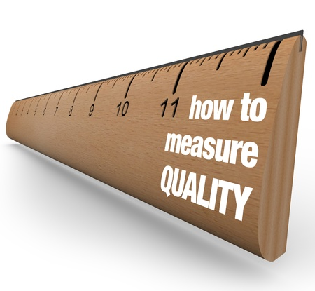A wooden ruler with the words How to Measure Quality, offering guidance on measuring results of process improvement and other means of fostering a betterment of qualities photo