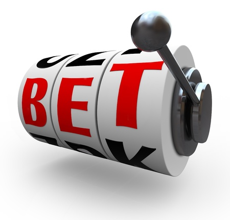 The letters in the word Bet line up for a jackpot on 3 slot machine wheels, symbolizing a jackpot of wealth, money, riches