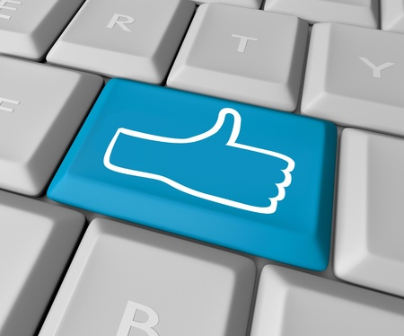 A keyboard with a blue key with the Thumb's Up like icon, illustrating that you approve or think highly of a website, article, person, or object on a social network or other information resource Stock Photo - 9748125