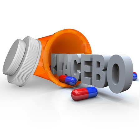 be or not to be: An open prescription medicine bottle on its side and spilled, with the word Placebo indicating it is not real medicine and rather inactive capsules to be given to a control group in a medical study Stock Photo