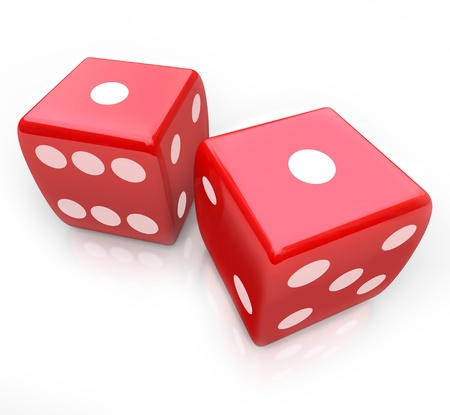 Two red dice with ones facing up symbolizing snake eyes, a score you might get in a gambing game at a casino photo