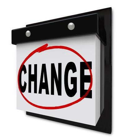 circled: Un calendario de pared con desgarro ubicaci�n p�ginas y la palabra cambio en c�rculo por un marcador rojo, destacando la importancia de autoayuda y evoluci�n