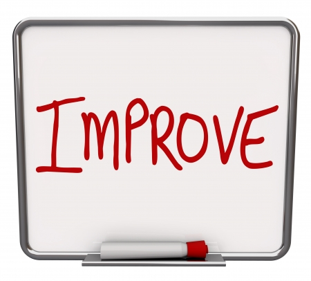 succeeding: A white dry erase board with red marker, with the word Improve, representing the drive to change or get better, succeeding over a challenge Stock Photo