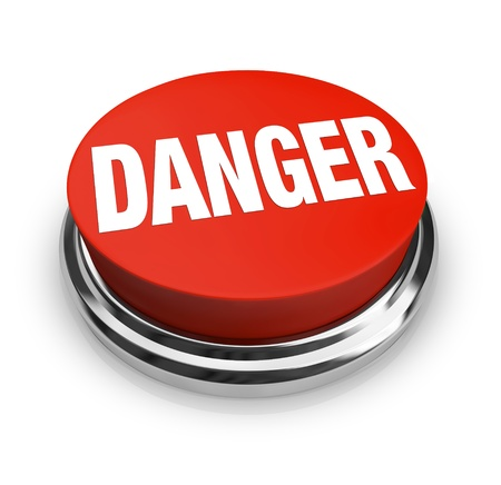 jeopardy: A red button with the word Danger, illustrating the hazards and need for caution in a situation.  Press the round button to alert the authorities or others around you to a dangerous problem! Stock Photo