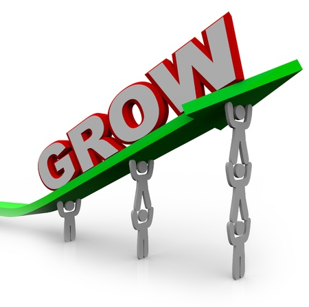 growing: A team of people lift an arrow and the word Grow, symbolizing the growth that can be achieved with many team members working toward a common objective