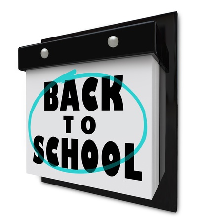 A wall calendar with tear-away pages, and the words Back to School reminding you that classes start soon photo