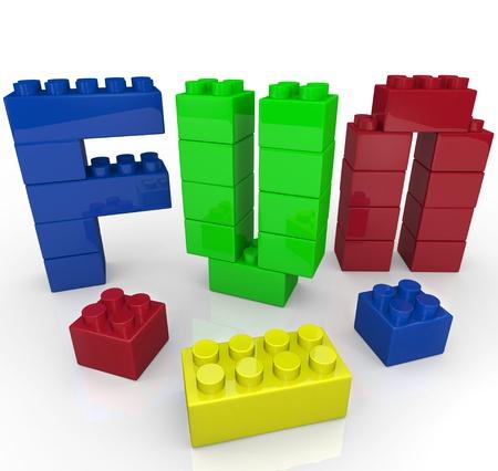 Het woord Fun gebouwd met plastic speelgoed bouwstenen in verschillende kleuren vertegenwoordigen de macht van fantasierijke en creatieve spelen
