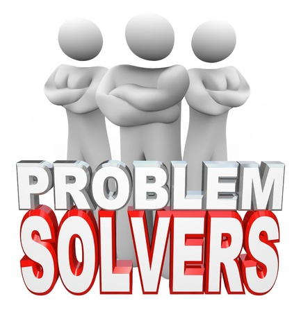 solve problems: A team of people, two women and one man, stand with arms folded behind the words Problem Solvers, ready to assist you in solving your problem, issue or trouble Stock Photo