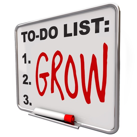 The word Grow written on a dry erase board telling you to achieve growth, either through maturity, education or life experience Stock Photo - 10244247