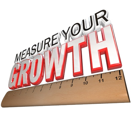 metrics: A ruler measuring the words Measure Your Growth Stock Photo