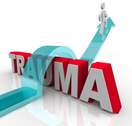 A person jumps over the word Trauma on an arrow, symbolizing the positive effects of theraphy and rehabilitation as well as a good attitude Stockfoto