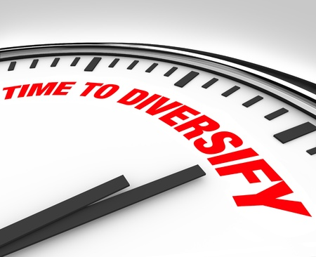 Spread your investments and manage your risk by diversifying your portfolio, following the advice of this clock with words reading Time to Diversify Stock Photo - 10322663