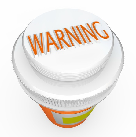 pill bottle prescription bottle: A white child-proof medicine bottle cap features the word Warning to caution you of dangerous side effects or the hazards of children or other loved ones taking pills not intended for them Stock Photo
