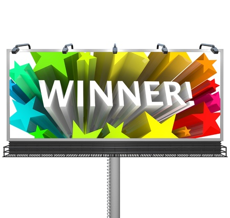 signage outdoor: An outdoor billboard announces to the word that the winner has been chosen and congratulates the lucky victor in the competition for the prize or successful candidate